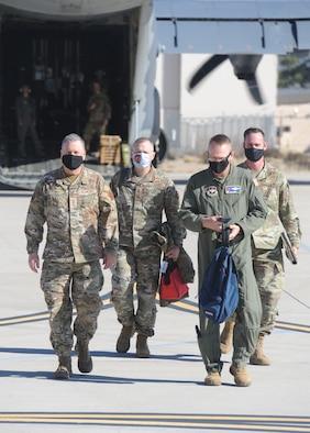AETC senior leaders walk from aircraft to hangar.