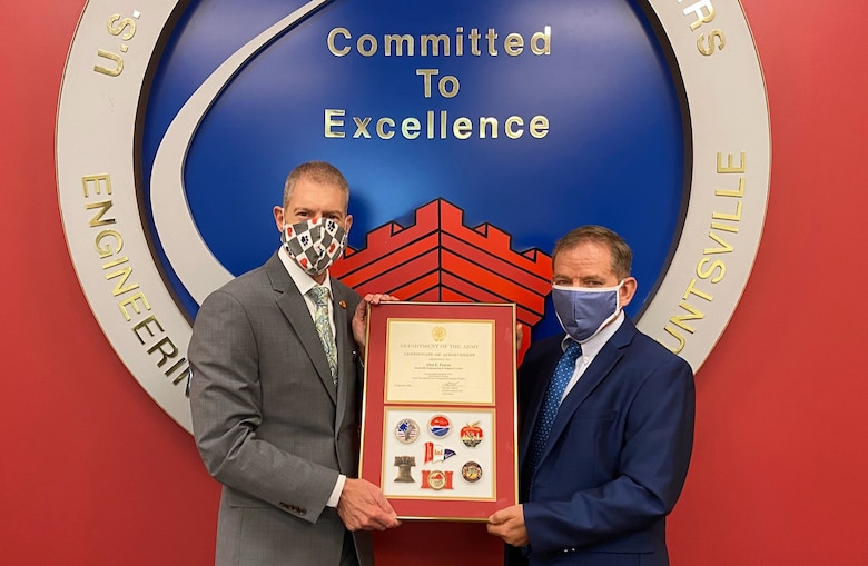 "Albert ""Chip"" Marin III, U.S. Army Engineering and Support Center programs director, (pictured right) presents a U.S. Army Certificate of Achievement to Alan Fearns, contracting officer, for successful completion of the U.S. Army Corps of Engineers North Atlantic Division's Executive Leadership Developmental Program."