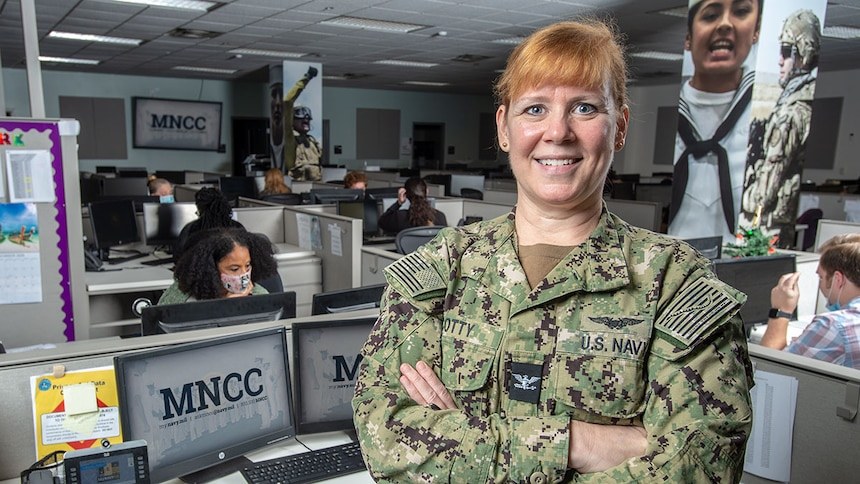 Director of MyNavy Career Center (MNCC), Capt. Laura Scotty, poses for an environmental portrait in the MyNavy Career Center.