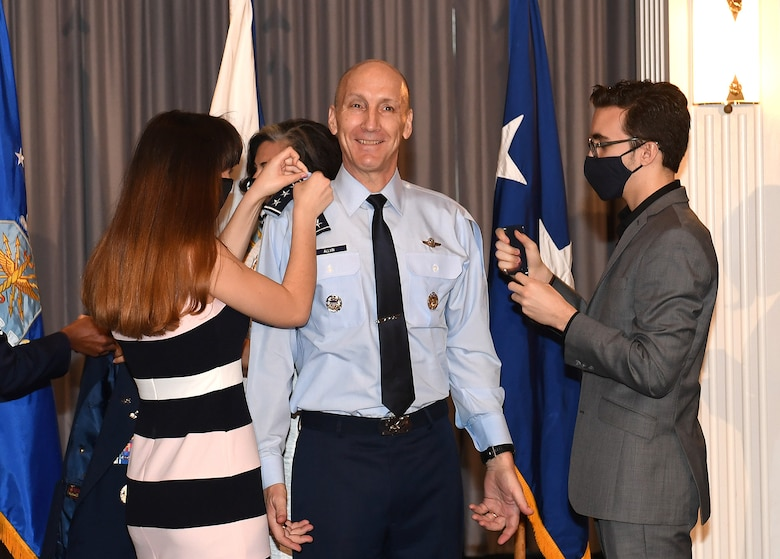 Gen. David Allvin's family places his new rank on his uniform during his promotion ceremony at Joint Base Anacostia-Bolling, Washington, D.C., Nov. 12, 2020. Allvin will serve as the 40th Vice Chief of Staff of the Air Force. (U.S. Air Force Photo by Andy Morataya)