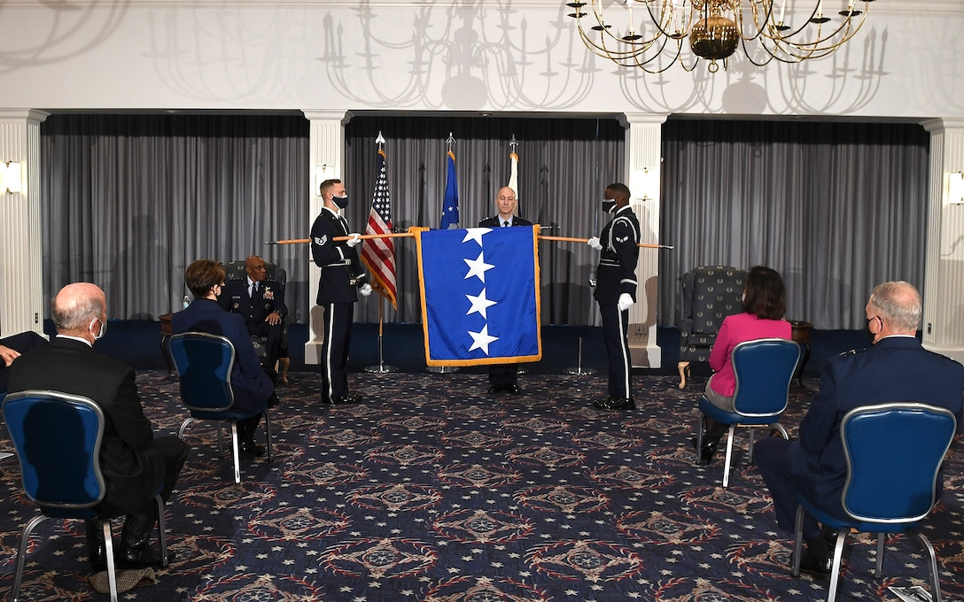 Members of the Air Force Honor Guard unfurl Gen. David Allvin's four-star flag during his promotion ceremony at Joint Base Anacostia-Bolling, Washington, D.C., Nov. 12, 2020. Allvin will serve as the 40th Vice Chief of Staff of the Air Force. (U.S. Air Force Photo by Andy Morataya)