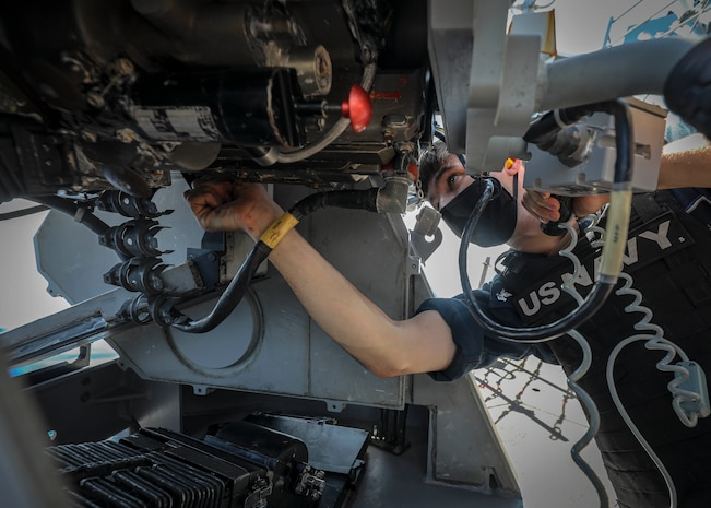 01109-N-WI365-1324 INDIAN OCEAN (Nov. 9, 2020) -- Fire Controlman 2nd Class Samuel Thomas puts a mark-38 25mm gun on safe after a pre-aim calibration live-fire exercise aboard the Arleigh Burke-class guided-missile destroyer USS John S. McCain (DDG 56).