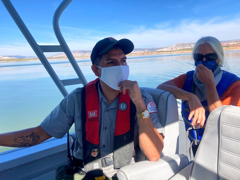 Abiquiu Lake park ranger Nathaniel Naranjo and Tori White, USACE-South Pacific Division chief of Operations and Regulatory, take a boat to reach the shoreline where they picked up trash during Abiquiu Lake's NPLD event, Sept. 26, 2020.