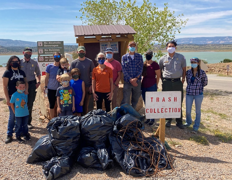 Abiquiu Lake project staff; Mark Yuska, chief of the USACE-Albuquerque District's Operations Division; Albuquerque District commander Lt. Col. Patrick Stevens and his family; Tori White, USACE-South Pacific Division chief of Operations and Regulatory; and Abiquiu Lake park ranger Nathaniel Naranjo stand next to some of the trash collected during Abiquiu Lake's NPLD event, Sept. 26, 2020.