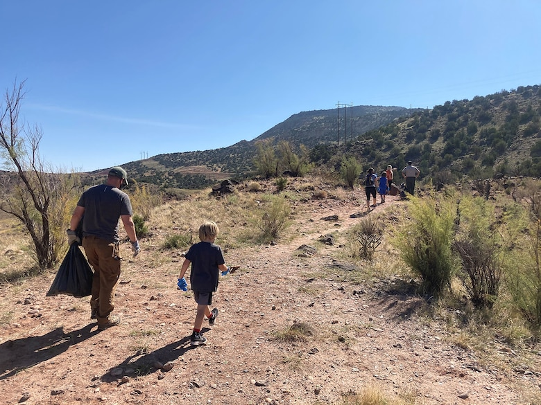 Albuquerque District commander Lt. Col. Patrick Stevens and his family join Tori White, South Pacific Division chief of Operations and Regulatory, and Abiquiu Lake park ranger Nathaniel Naranjo in picking up trash at Abiquiu Lake, Sept. 26, 2020.