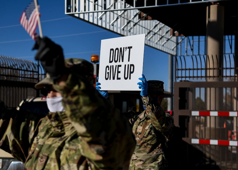 Airman hold up signs of support.