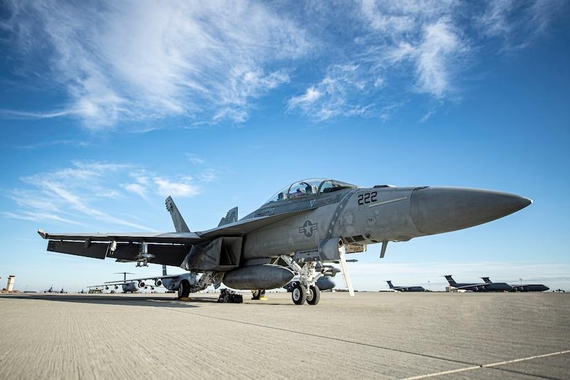 An F-18F Super Hornet sits on a flightline.