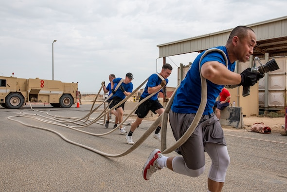 U.S. Air Force Airmen assigned to the 407th Expeditionary Security Forces Squadron and the 407th Civil Engineer Squadron play cornhole during the Battle of the Badges event at Ahmed Al Jaber Air Base, Kuwait, Nov. 11, 2020.