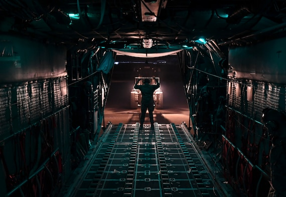 A U.S. Air Force Airman guides a forklift to unload cargo from a C-130 Hercules Oct. 30, 2020.