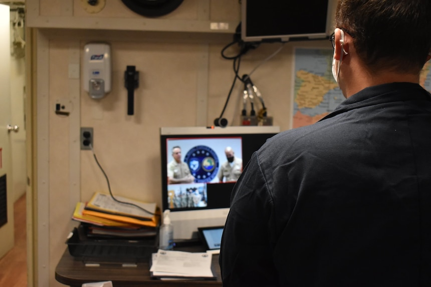 """Adm. Robert P. Burke, commander, U.S. Naval Forces Europe-Africa and Fleet Master Chief Derrick A. Walters recognize work performance and Signature Behaviors during a virtual """"Bravo Strike"""""""