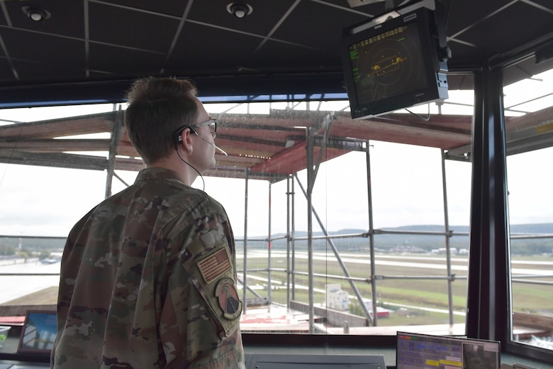 An Airman staring at a radar screen.