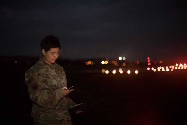 An Airman holding a cell phone.