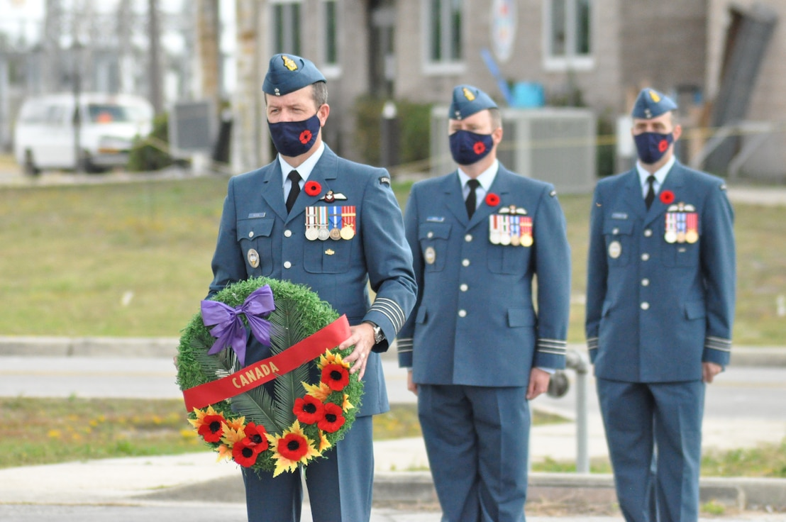 Canadian officers Col. Clay Rook, Lieutenant-Colonel Mark Hickey, and Maj Kevin Foster prepare to dedicate wreaths of remembrance on behalf of the Canadian Government, the Royal Canadian Airforce, and Canadian Detachment Tyndall, respectively at the Canadian Detachment Tyndall Remembrance (Veteran's) Day parade at Tyndall Air Force Base, Fla.