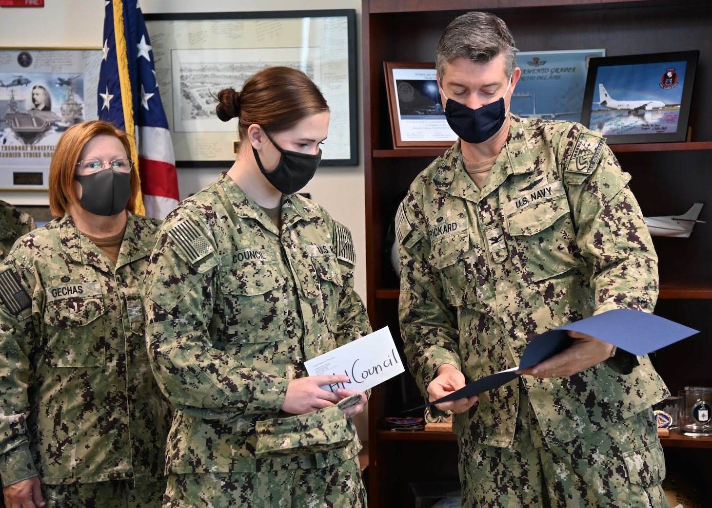 "Adm. Robert P. Burke, commander, U.S. Naval Forces Europe-Africa and Fleet Master Chief Derrick A. Walters recognize  work performance and Signature Behaviors during a virtual ""Bravo Strike"""