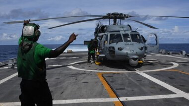 "An MH-60S Seahawk assigned to the ""Sea Knights"" of Helicopter Sea Combat Squadron (HSC) 22 lands on the flight deck of the Freedom-class littoral combat during a medical evacuation (MEDEVAC), Nov. 11, 2020. Sioux City is deployed to the U.S. 4th Fleet area of operations to support Joint Interagency Task Force South's mission, which includes counter illicit drug trafficking in the Caribbean and Eastern Pacific. (U.S. Navy photo by Mass Communication Specialist Seaman Juel Foster/Released)"