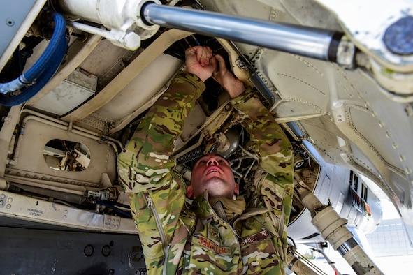 An Airman tightens a bolt.