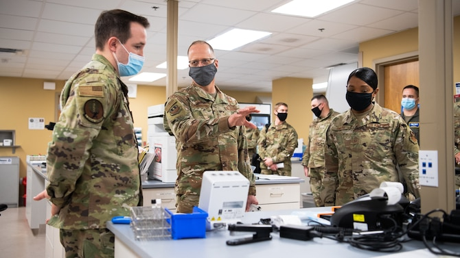 Maj. Gen. Mark E. Weatherington, 8th Air Force and Joint-Global Strike Operations Center commander, and Chief Master Sgt. Melvina A. Smith, 8th AF and J-GSOC command chief, visit the 2nd Medical Group laboratory during their official visit to the 2nd Bomb Wing at Barksdale Air Force Base, La., Nov. 12, 2020.  Weatherington and Smith were both briefed on the current COVID-19 protocols taking place at Barksdale. (U.S. Air Force photo by Airman 1st Class Jacob B. Wrightsman)