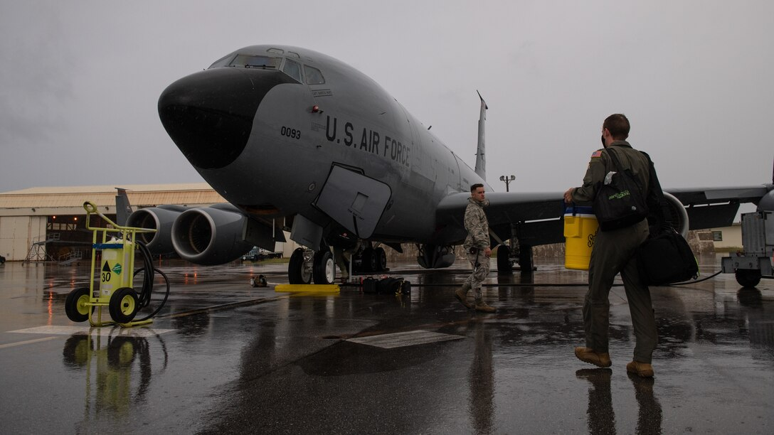 U.S. Air Force Airman 1st Class Travis Lee, 718th Aircraft Maintenance Squadron internal flight control systems journeyman, and Tech. Sgt. Michael Newman, 909th Aerial Refueling Squadron boom operator, prepare a KC-135 Stratotanker for a training sortie, Nov. 13, 2020, at Kadena Air Base, Japan. The 909th ARS conducted aerial refueling operations with B-1B Lancers in support of a Bomber Task Force deployment. (U.S. Air Force photo by Staff Sgt. Peter Reft)