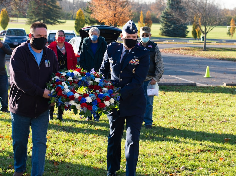 Jeff Gore, City of Huber Heights, Ohio mayor, and U.S. Air Force Col. Ivan Herwick, 88th Communications Group commander, lay a wreath during the city's Veterans Day Ceremony, Nov. 11, 2020. Members of Wright-Patt also provided they keynote address and performed the raising of the colors.