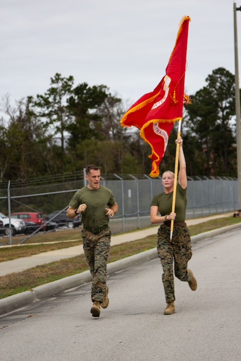 Marine Forces Special Operations Command participate in the annual Marine Corps Birthday Run on Camp Lejeune, California, Nov. 6, 2020. Groups of Marines each ran 2 miles totaling 245 miles in celebration of the 245th Marine Corps birthday. COVID-19 restrictions have changed the way Marines across the globe are celebrating the Corps' 245th birthday. The annual galas, held to commemorate the founding of Marine Corps, have been scaled back to ensure the health of the force while ensuring the most meaningful aspects of the festivities remain untouched.  (U.S. Marine Corps photo by Cpl. Jesula Jeanlouis)