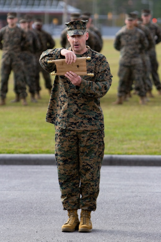Lt. Col. Michael S. Beames, assistant chief of staff, administration, with Marine Forces, Special Operations Command, reads the birthday message from Gen. John A. Lejeune, 13th commandant of the Marine Corps, during the 245th Marine Corps Birthday cake cutting ceremony at Camp Lejeune, North Carolina, Nov. 6, 2020. COVID-19 restrictions have changed the way Marines across the globe are celebrating the Corps' 245th birthday. The annual galas, held to commemorate the founding of Marine Corps, have been scaled back to ensure the health of the force while ensuring the most meaningful aspects of the festivities remain untouched.  (U.S. Marine Corps photo by Cpl. Jesula Jeanlouis)