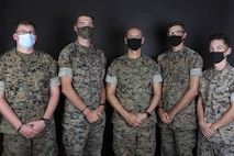U.S. Marines Cpl. Colton Lahr, Cpl. Benjamin Wisneski, Gunnery Sgt. Candido DeLeon Jr., Lance Cpl. Mackenzie Langaker and Lance Cpl. Jonathan Stevens pose for a photo on Marine Corps Base Camp Pendleton, California, Oct. 2, 2020. Together, the five Marines helped evacuate families and pets during the DeLuz fire. The fire burned approximately 25 acres Sept. 30, threatening homes and the child development center in the DeLuz Housing area on Camp Pendleton. (U.S. Marine Corps photo illustration by Lance Cpl. Kerstin Roberts)