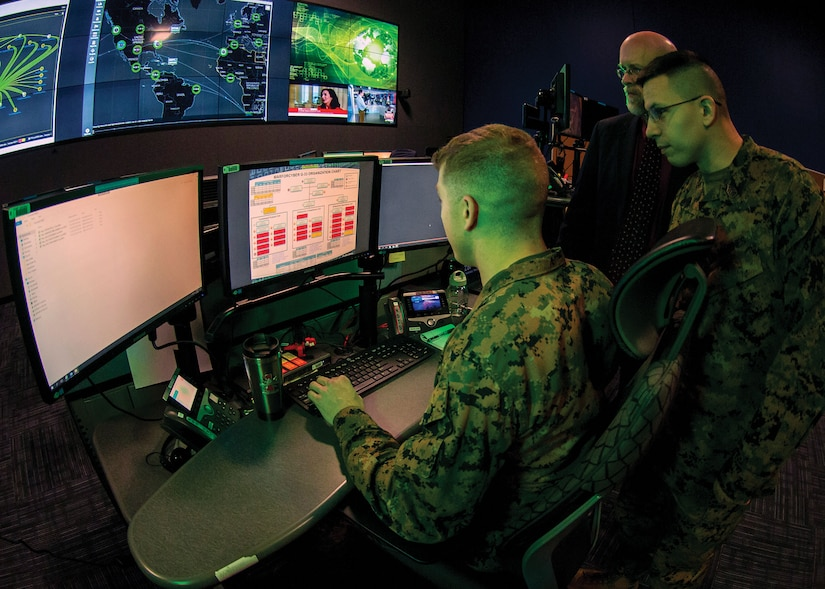 Marines with Marine Corps Forces Cyberspace Command in operations center at Lasswell Hall aboard Fort Meade, Maryland