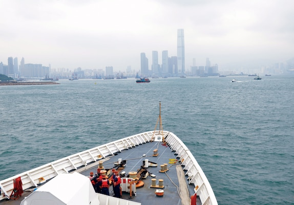 U.S. Coast Guard Cutter Bertholf crewmembers watch from cutter's forecastle as Bertholf navigates toward Hong Kong, April 15, 2019 (U.S. Coast Guard/Matthew S. Masaschi)
