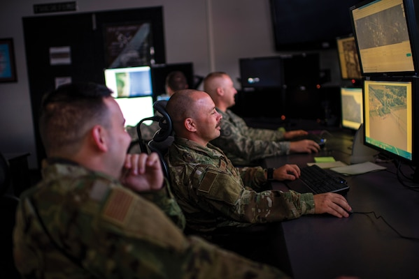 Air National Guard intelligence analysts assigned to 181st Intelligence Wing, 137th Intelligence Squadron Unclassified Processing, Assessment, and Dissemination site test new domestic response artificial intelligence technology at Hulman Field Air National Guard Base, Indiana, November 2, 2019 (U.S. Air National Guard/L. Roland Sturm)