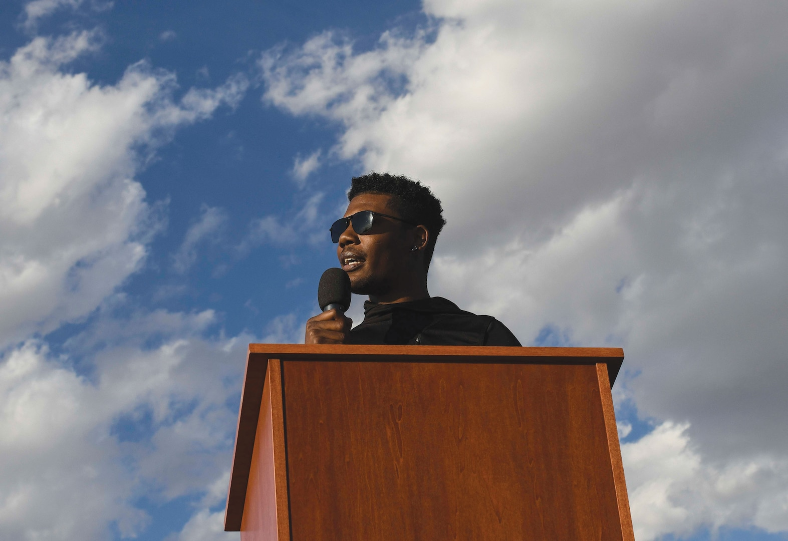 """Senior Airman Marcel Williams, 27th Special Operations Wing public affairs broadcaster, speaks at """"Gathering for Unity"""" event"""