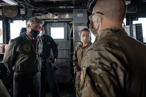 Members of USS Normandy visit, board, search, and seizure team brief Navy Secretary Kenneth Braithwaite on seizure of illicit shipment of advanced weapons and weapon components