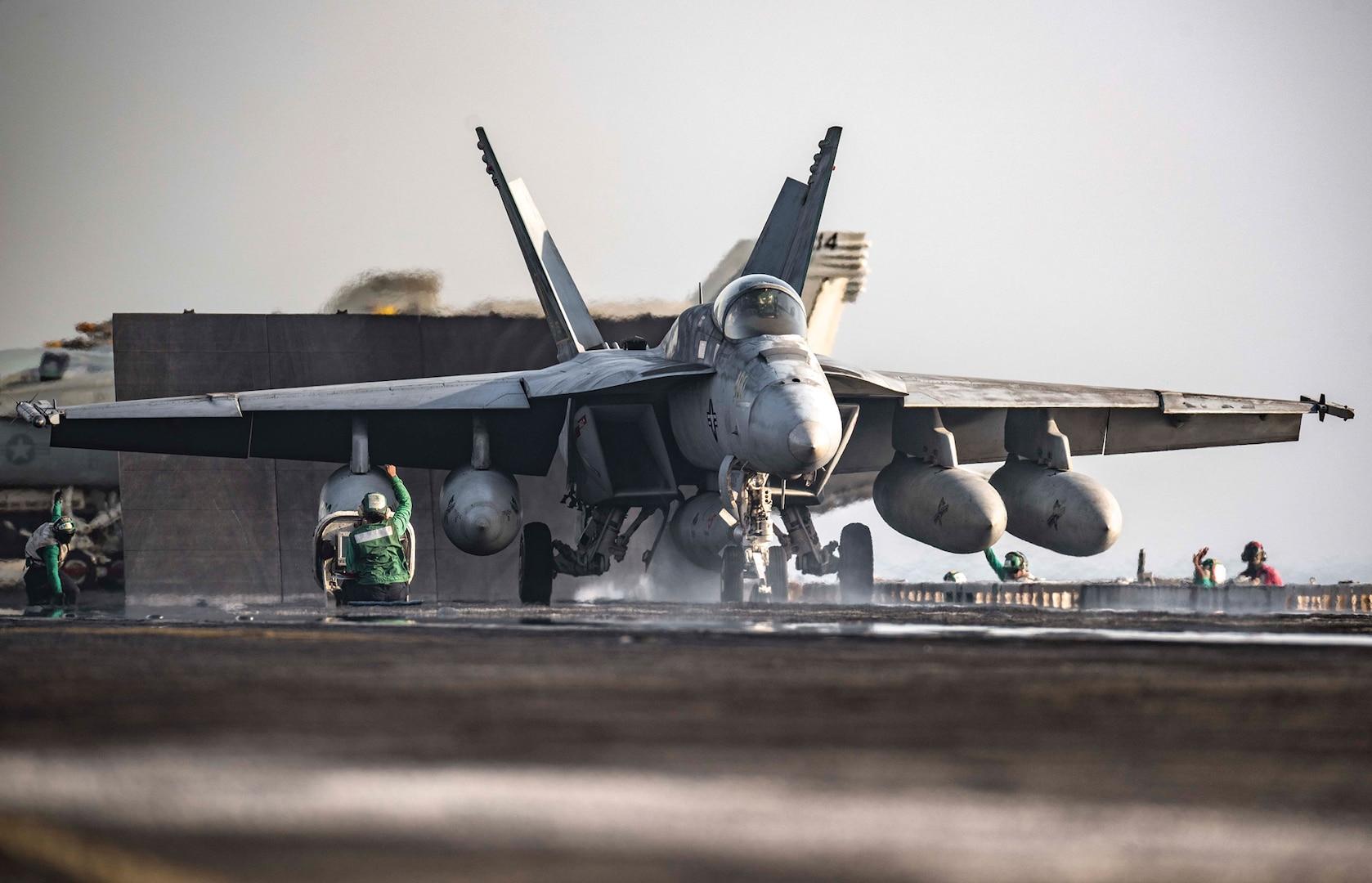 F/A-18E Super Hornet launches from flight deck of USS Dwight D. Eisenhower