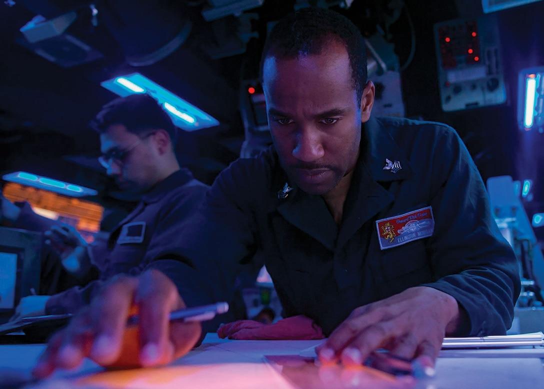 Sailor tracks contact bearings during Taiwan Strait transit aboard USS Shiloh