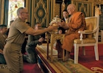 Chaplain (Captain) James Johnson, USN, presents gift to Supreme Patriarch of Thailand