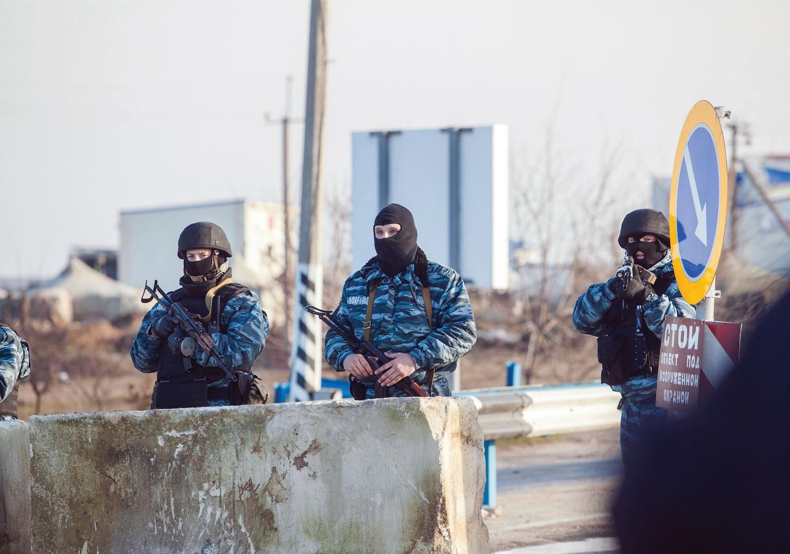 Berkut (Ukrainian riot police) man checkpoint at entrance to Crimean Peninsula