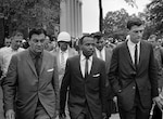 James Meredith walks to class at University of Mississippi accompanied by U.S. Marshal James McShane (left) and John Doar of Justice Department, October 1, 1962
