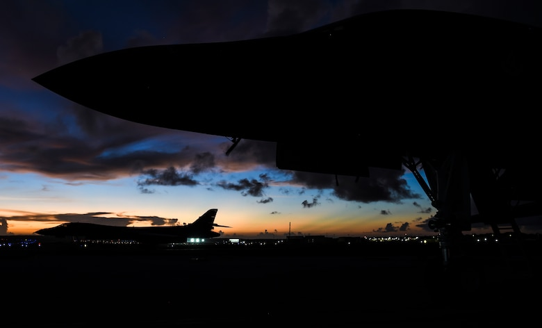 Two U.S. Air Force B-1B Lancers sit on the flightline after participating in a joint interoperability exercise at Andersen Air Force Base, Guam, Nov. 13, 2020. The exercise enabled the aircrew to test long-range force packaging and demonstrate global reach capabilities in the Indo-Pacific region. (U.S. Air Force photo by Staff Sgt. David Owsianka)