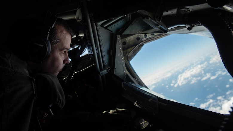 U.S. Air Force Tech. Sgt. Michael Weidman, 909th Aerial Refueling Squadron boom operator, scans the airspace for fuel receivers during a training sortie, Nov. 13, 2020, over the Pacific Ocean off the coast of Japan. The 909th ARS provided support to a B-1B Lancer Bomber Task Force mission, enabling deployed units to extend operational range, time on station, and integration throughout the U.S. Indo-Pacific Command area of responsibility. (U.S. Air Force photo by Staff Sgt. Peter Reft)