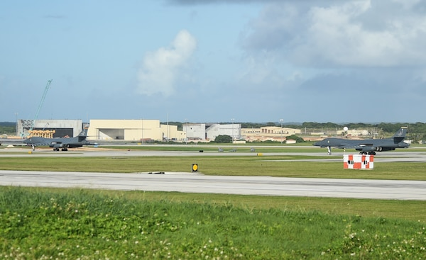 Two U.S. Air Force B-1B Lancers with the 9th Expeditionary Bomb Squadron taxi on a runway during a joint interoperability exercise at Andersen Air Force Base, Guam, Nov. 13, 2020. U.S. Air Force B-1B Lancers from the continental U.S. flew alongside the aircraft with the 9th EBS to demonstrate the bomber aircraft's global reach and long-range strike capabilities as they trained in the Indo-Pacific region. (U.S. Air Force photo by Staff Sgt. David Owsianka)