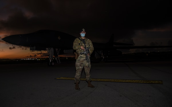 The U.S. Air Force security forces officer in-charge with the 9th Expeditionary Bomb Squadron stands near a U.S. Air Force B-1B Lancer on the flightline at Andersen Air Force Base, Guam, Nov. 13, 2020. Security forces personnel provided constant security for the aircraft during the Bomber Task Force deployment. (U.S. Air Force photo by Staff Sgt. David Owsianka)