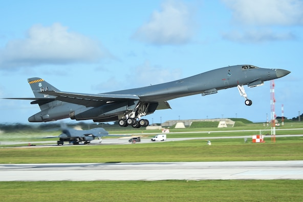 Aircrew with the 9th Expeditionary Bomb Squadron raise the landing gear of a U.S. Air Force B-1B Lancer during take-off in a joint interoperability exercise at Andersen Air Force Base, Guam, Nov. 13, 2020. Participating in the exercise allowed B-1 aircrews to obtain training that could be imperative in the future missions as they continue to stay committed to the security and stability of the Indo-Pacific region. (U.S. Air Force photo by Staff Sgt. David Owsianka)
