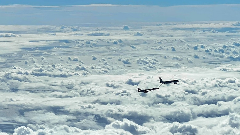 A U.S. Air Force B-1B Lancer and a 909th Aerial Refueling Squadron KC-135 Stratotanker, assigned to Kadena Air Base, Japan, conduct aerial refueling operations during a Bomber Task Force mission, Nov. 13, 2020, over the Pacific Ocean. Bomber Task Force deployments demonstrate U.S. commitment to allies and partners and they train regularly with other units throughout the theater in order to maintain a free and open Indo-Pacific. (U.S. Air Force courtesy photo by 909th Aerial Refueling Squadron)
