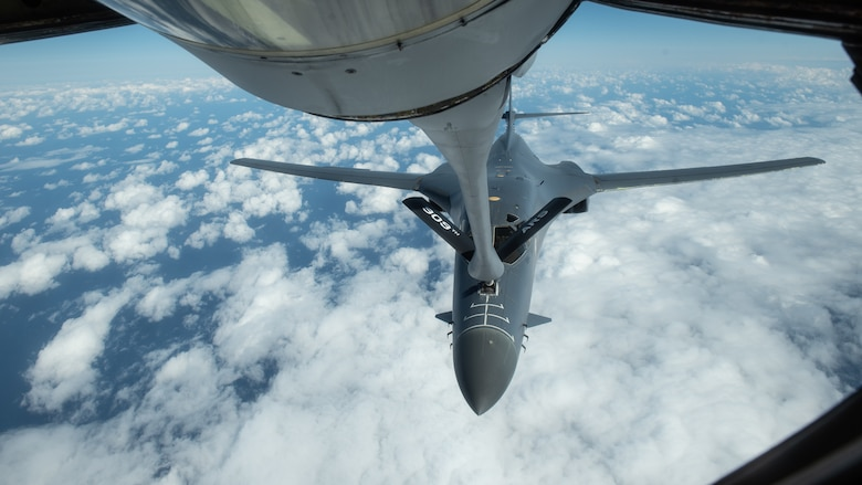 A U.S. Air Force B-1B Lancer receives fuel from a 909th Aerial Refueling Squadron KC-135 Stratotanker during a Bomber Task Force mission, Nov. 13, 2020, over the Pacific Ocean. The B1-B Lancers are deployed as a Bomber Task Force which enables Airmen to continuously conduct operations throughout the world, maintain global stability and security, and familiarize units with joint and bilateral operations in different regions. (U.S. Air Force photo by Staff Sgt. Peter Reft)