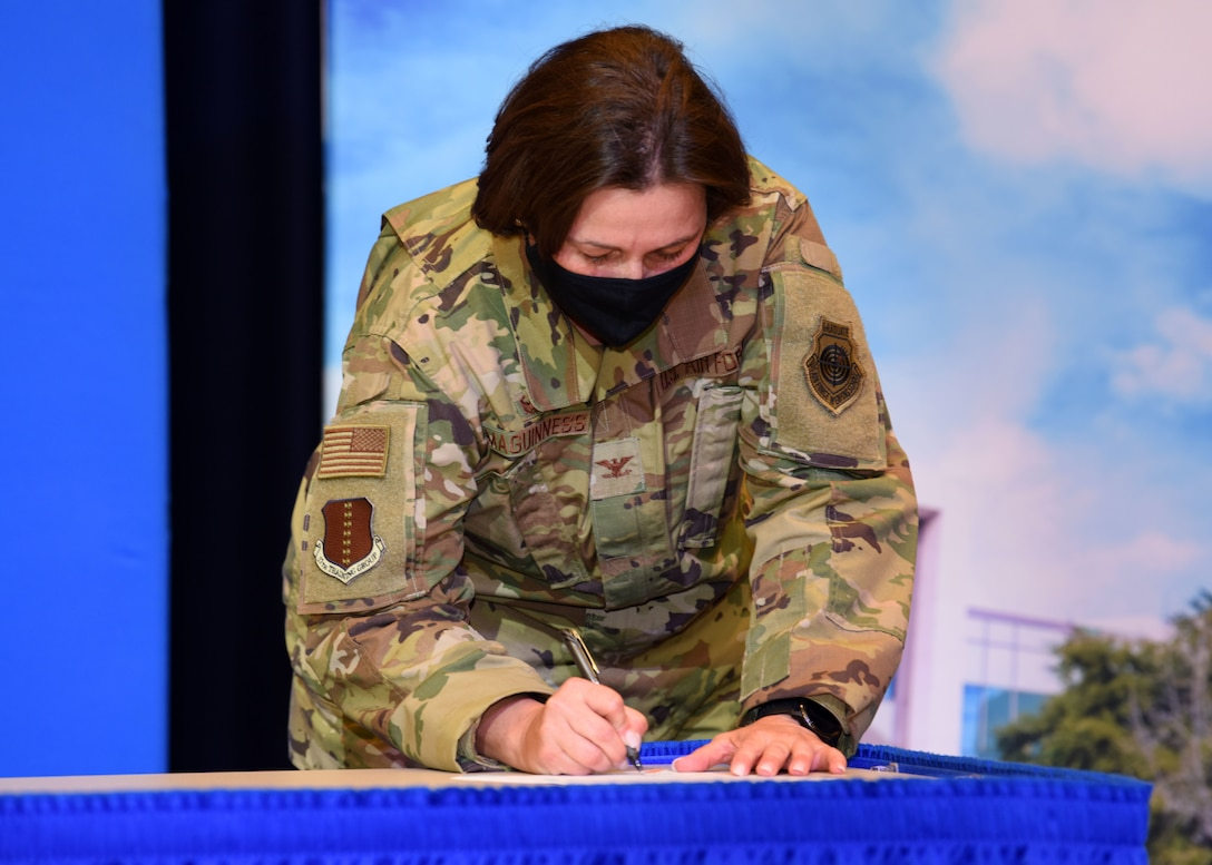U.S. Air Force Col. Angelina Maguinness, 17th Training Group commander, signs the Memorandum of Understanding between Angelo State University and Goodfellow Air Force Base during the transfer agreement signing at the Houston Harte University Center, Nov. 13, 2020. Maguinness' team worked the agreement with ASU over the course of five years. (U.S. Air Force photo by Airman 1st Class Ethan Sherwood)