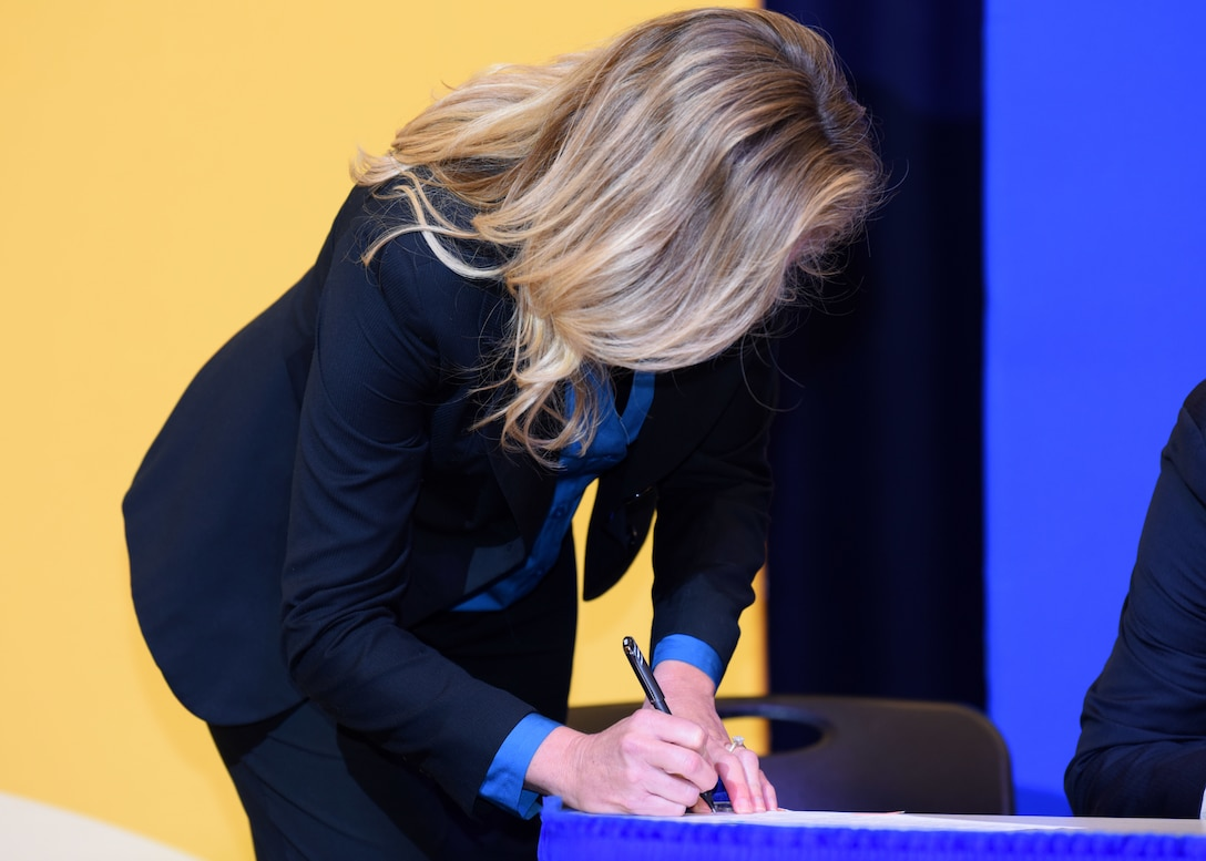 Dean of the College of Education, Dr. Scarlet Clouse, signs the Memorandum of Understanding between Angelo State University and Goodfellow Air Force Base during the transfer agreement at the Houston Harte University Center, Nov. 13, 2020. ASU is providing this service as a way for military members to further their education. (U.S. Air Force photo by Airman 1st Class Ethan Sherwood)