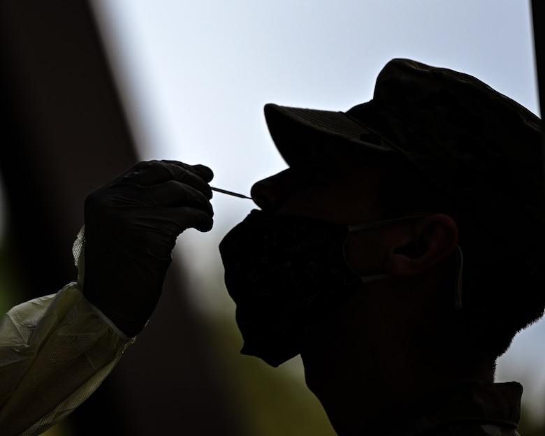 A U.S. Air Force Airman receives a nasal swab during pre-deployment COVID testing.