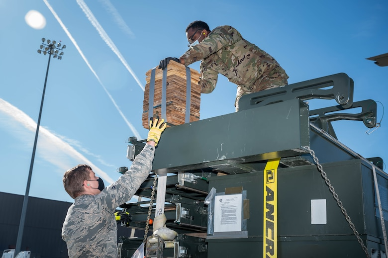 U.S. Air Force Airmen from the 633rd Logistics Readiness Squadron move cargo.