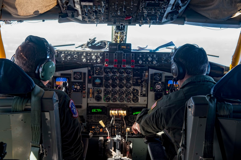 U.S. Air Force 1st Lt. Jake Erickson (left) and Maj. Frank Simon (right), 93rd Air Refueling Squadron KC-135 Stratotanker pilots, operate a KC-135 en route to conduct an aeromedical evacuation in Japan, Nov. 10, 2020. Aeromedical evacuation missions consist of critical care transport teams executing patient movement and care using mobility aircraft such as the C-17 Globemaster III, C-130 Hercules and KC-135. (U.S. Air Force photo by Senior Airman Lawrence Sena)