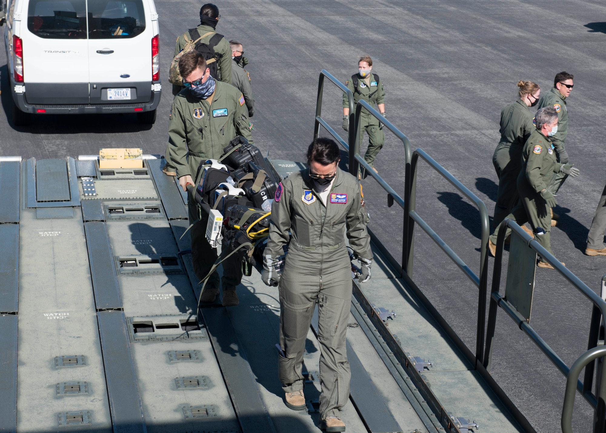 U.S. Air Force Capt. Amanda Scanlon, 18th Aeromedical Evacuation Squadron flight nurse, and U.S. Air National Guard Tech. Sgt. Alex Klinger, 187th AES aeromedical evacuation technician, loaded a litter of AE supplies on a KC-135 Stratotanker at Joint Base Pearl Harbor-Hickam, Hawaii, Nov. 10, 2020. By working with Pacific Air Force and Total Force partners from the 187th AES and 18th AES, Team Fairchild Airmen were able to ensure a continued investment in a high quality of life and medical service for Airmen and joint partners in the Pacific. (U.S. Air Force photo by Senior Airman Lawrence Sena)