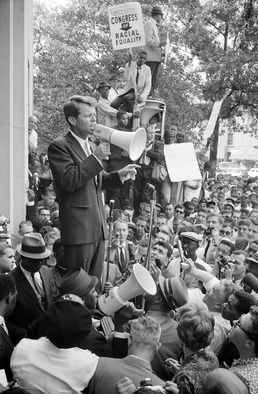 Attorney General Robert F. Kennedy speaks to crowd about racial equality, outside Justice Department, June 14, 1963